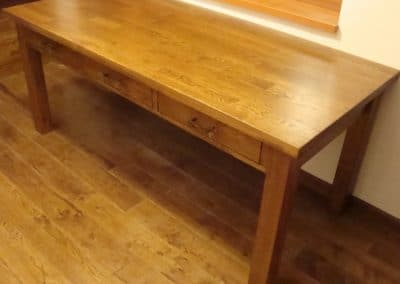 Solid oak flooring 120 mm width, Rustic quality, varnished, color Golden Oak and oak table 1600 x 900 mm, with drawers, varnished, color Golden Oak