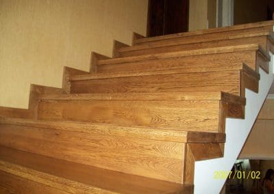 Oak stairs continuous lamellas, quality Nature, brushed, color Brown patina, skirting boards 50 mm