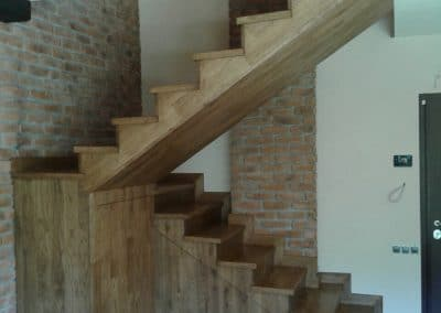 Oak stairs continuous lamellas, Rustic quality and a complete paneling of a metal staircase construction, oiled, color Antique oak